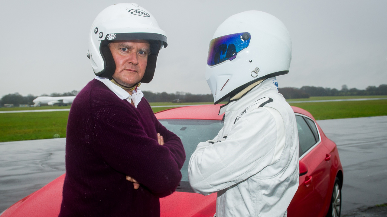 Hugh Bonneville and The Stig: surprised.