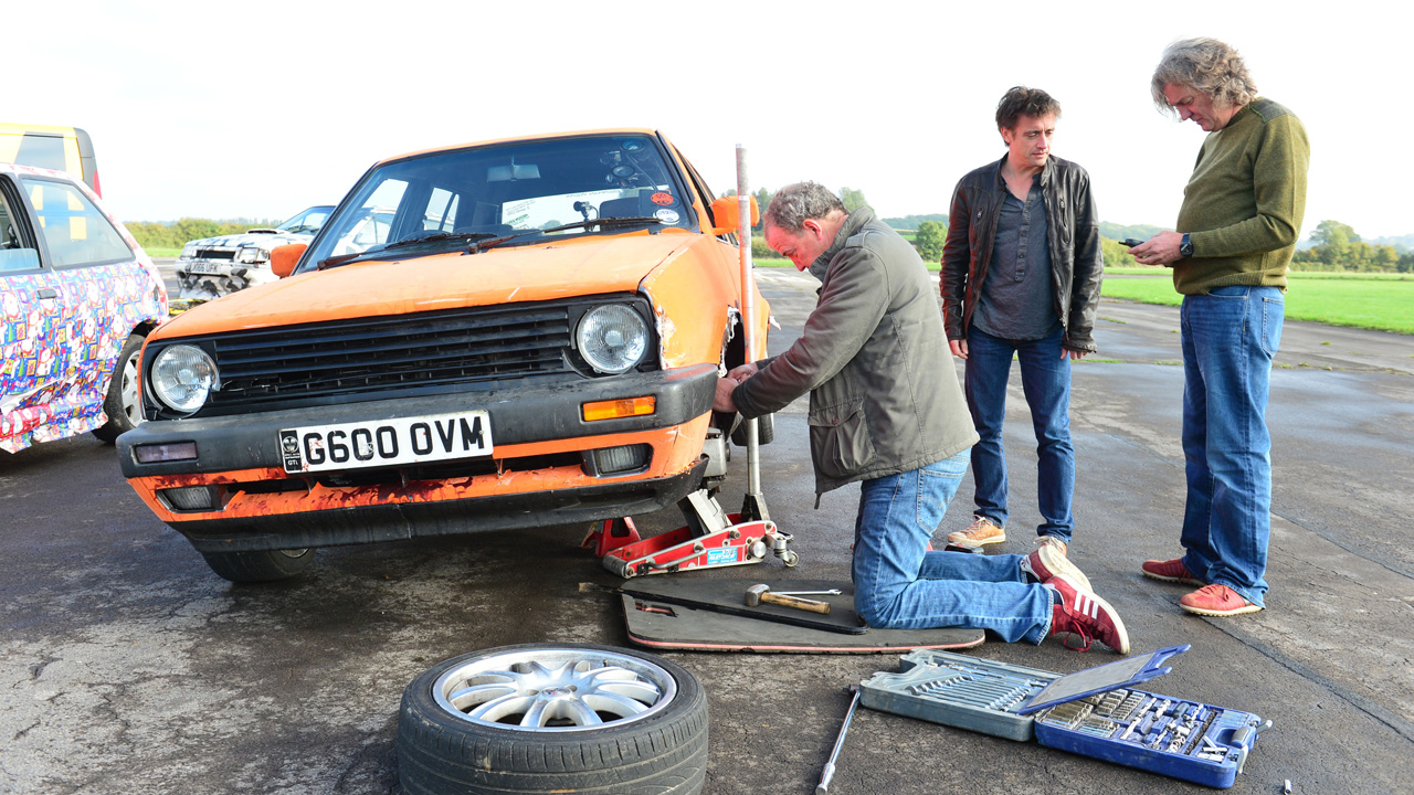 Jeremy Clarkson, Richard Hammond and James May repairing Jeremy's Volkswagen Golf GTi Mk2.