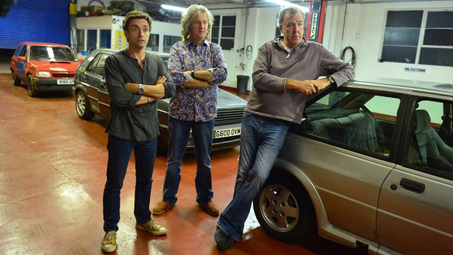 Richard Hammond, James May and Jeremy Clarkson in the Top Gear antique restoration center with their Hot Hatches.