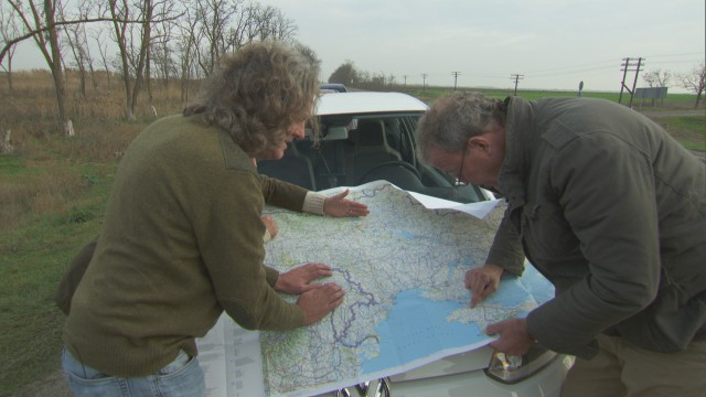 Richard Hammond, James May and Jeremy Clarkson reviewing the road map in Ukraine