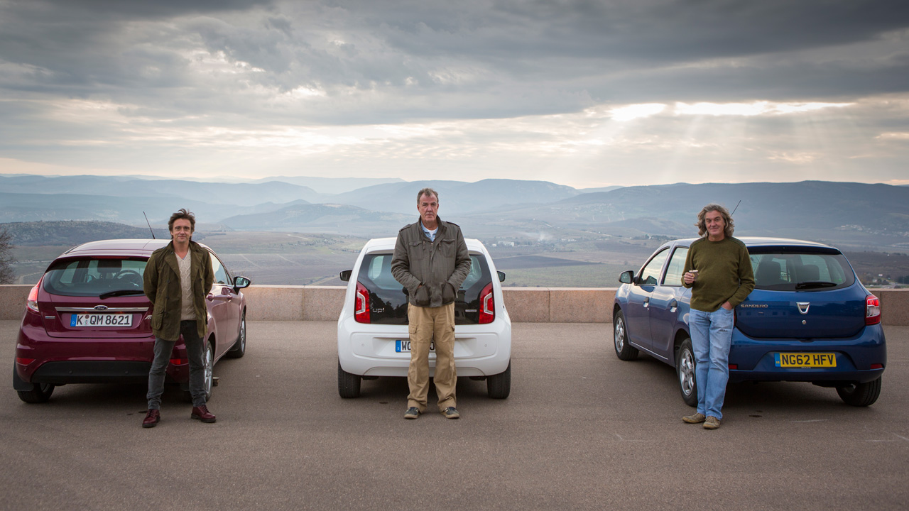 Richard Hammond, Jeremy Clarkson and James May with their Ford Fiesta, Volkswagen Up and Dacia Sandero – site of the charge of the light brigade behind them