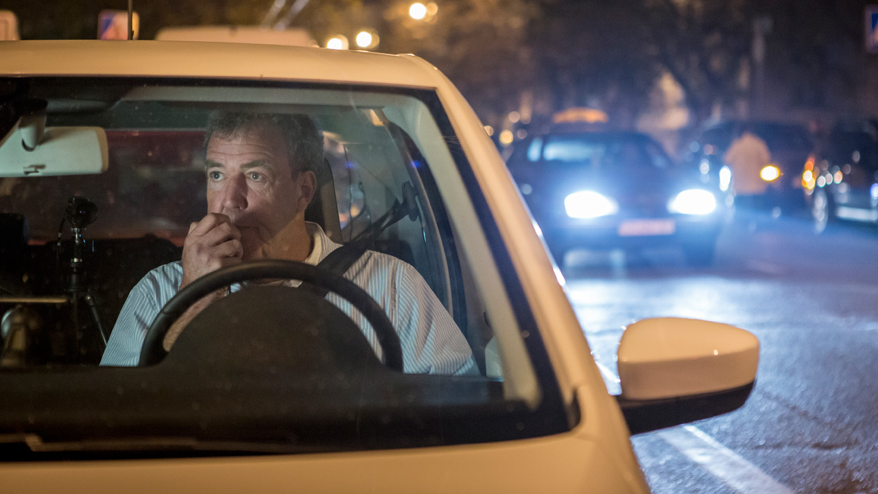Jeremy Clarkson driving a Volkswagen Up at night