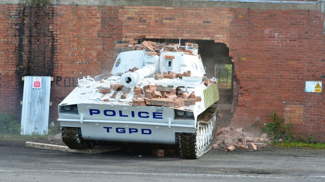 The Top Gear Police Department Tank smashing through a wall.