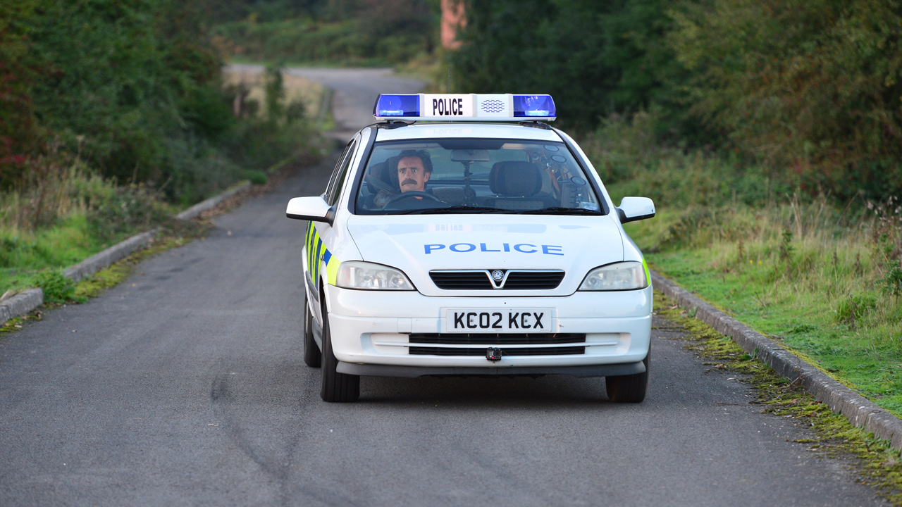 Richard Hammond driving the Top Gear Police Department Vauxhall Astra.