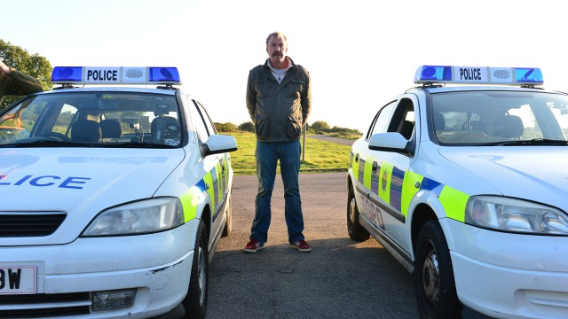 Jeremy Clarkson with the Top Gear Police Department cars.