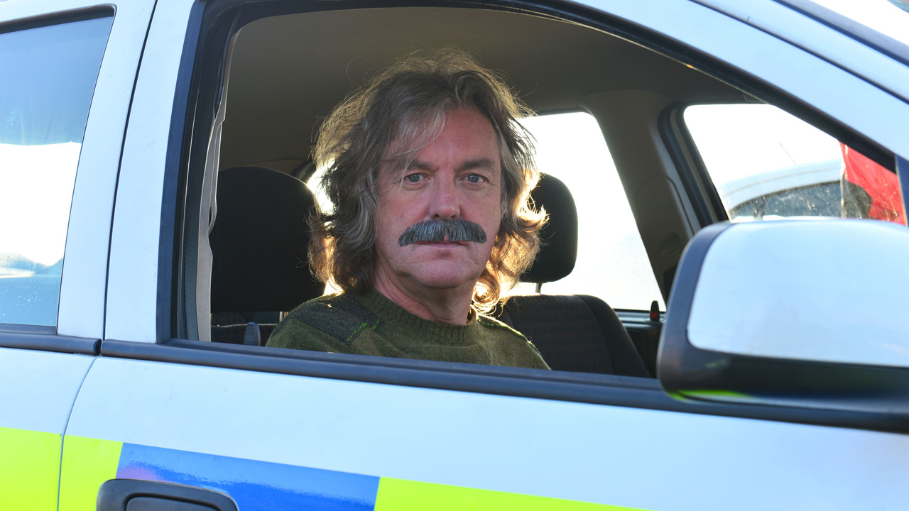 James May in the Top Gear Police Department Vauxhall Astra.