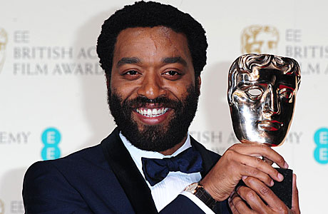 Chiwetel Ejiofor picks up his BAFTA award for best actor