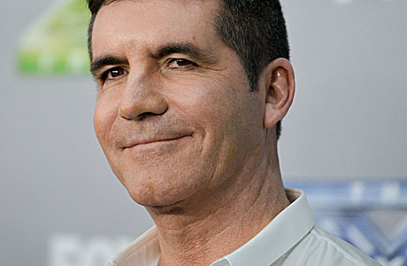 Simon Cowell at the season finale of the X Factor (Photo by Richard Shotwell/Invision/AP)
