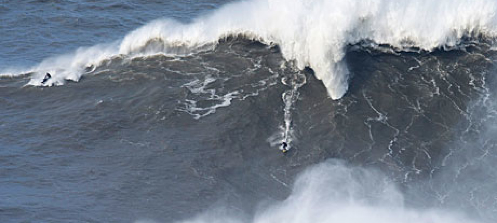 Andrew Cotton rides an 80ft wave