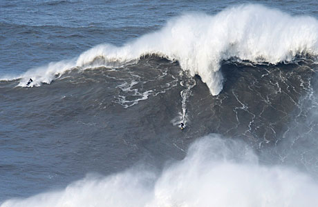 Andrew Cotton rides an 80ft wave (AP Photo/Miguel Barreira)
