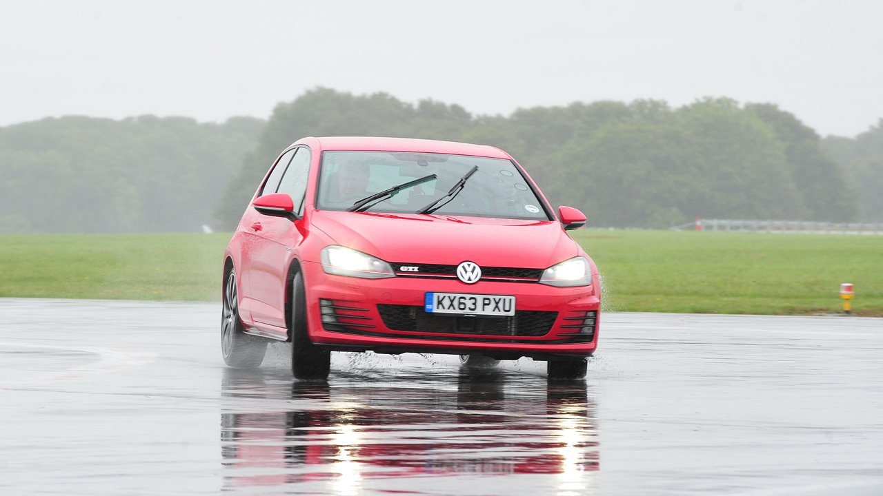 Jeremy Clarkson driving the Volkswagen Golf GTI at the Top Gear Test Track