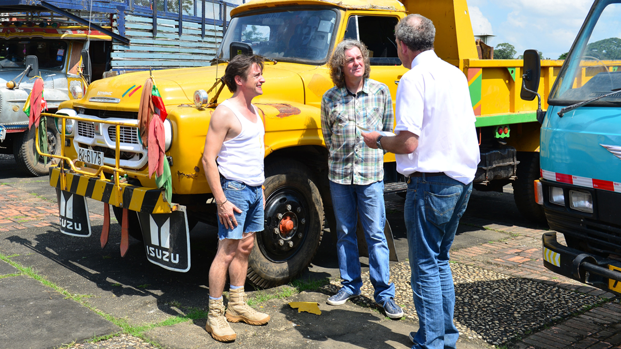 Richard Hammond, James May and Jeremy Clarkson with their lorries in Yangon, Burma