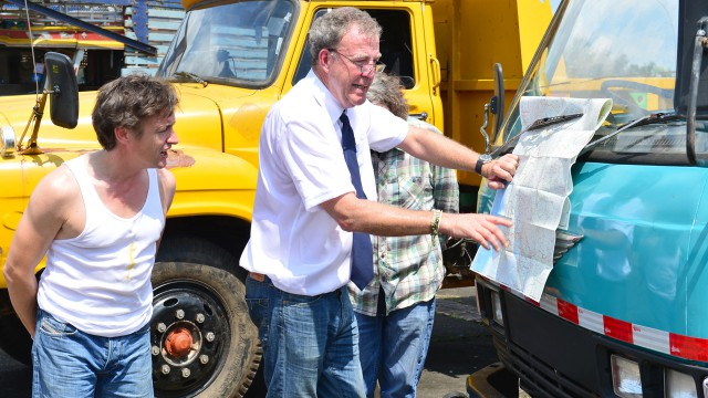 Richard Hammond, James May and Jeremy Clarkson reading a map in Yangon, Burma
