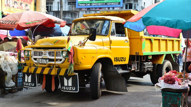 Jeremy Clarkson driving his Isuzu TXD lorry through the streets of Yangon in Burma