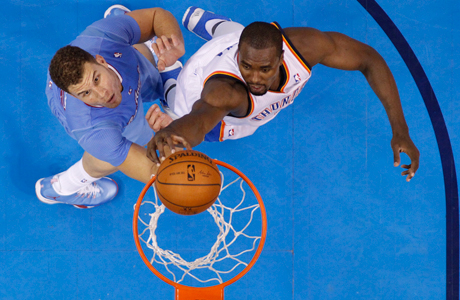 Oklahoma City Thunder forward Serge Ibaka (9) dunks on Los Angeles Clippers forward Blake Griffin. (Photo: Sue Ogrocki/AP)