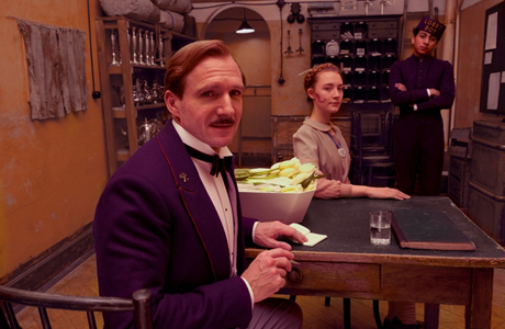 Ralph Fiennes (with Saoirse Ronan and Tony Revolori) in 'The Grand Budapest Hotel' (Photo: Fox Searchlight)