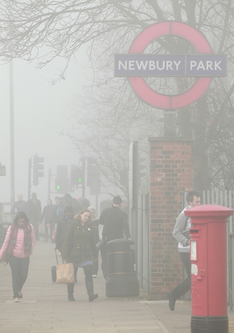 Spring weather March 13th. Commuters make their way in the fog to Newbury Park Underground Station, in east London, as fog covered much of the UK leading to transport problems. Picture date: Thursday March 13, 2014. See PA story TRANSPORT Fog. Photo credit should read: Sean Dempsey/PA