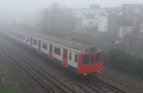 Spring weather March 13th. A District line underground train makes its way on the line between Richmond and Kew Gardens where visibility at times is less than 50 metres. A number of flights across the UK have been cancelled because of early morning fog. Picture date: Thursday March 13, 2014. See PA story TRANSPORT Fog. Photo credit should read: Martin Keene/PA Wire URN:19281790