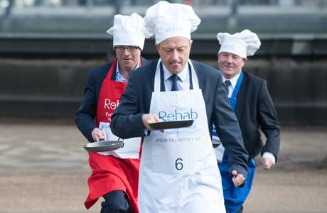 Journalist Nick Robinson (L), Jason McCartney MP (C) and Lord Mawson (R) Rehab Parliamentary Pancake Race in Victoria Tower Gardens, Westminster, London, Britain - 04 Mar 2014 The charity race is organised as a competition between journalists, MPs and members of the House of Lords and proceeds are given to the charity 'Rehab'.  (Rex Features via AP Images)