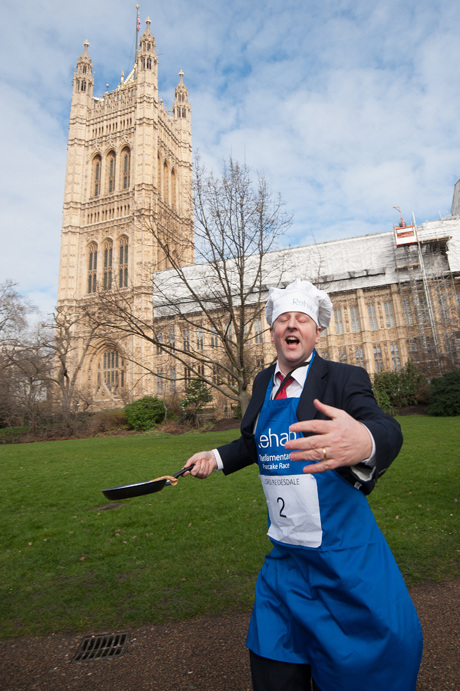 Lord Redesdale Rehab Parliamentary Pancake Race in Victoria Tower Gardens, Westminster, London, Britain - 04 Mar 2014 The charity race is organised as a competition between journalists, MPs and members of the House of Lords and proceeds are given to the charity 'Rehab'.  (Rex Features via AP Images)