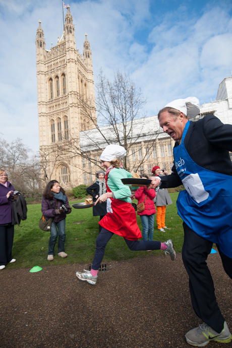 Journalist Jane Merrick (L) and Lord St John (R) Rehab Parliamentary Pancake Race in Victoria Tower Gardens, Westminster, London, Britain - 04 Mar 2014 The charity race is organised as a competition between journalists, MPs and members of the House of Lords and proceeds are given to the charity 'Rehab'.  (Rex Features via AP Images)