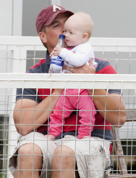 Peter Phillips kissing baby Savannah Festival of British Eventing, Gatcombe Park, Gloucestershire, Britain - 05 Aug 2011  (Rex Features via AP Images)