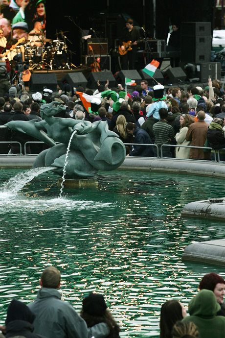 Thousands of people gather in Trafalgar Square in central London, where the fountains are coloured green during the free concert festival in celebration of St Patrick's Day, Sunday, March 12, 2006. Some thousands of people participated in a St. George's Day parade through the streets of London, ending with the concert in Trafalgar Square.(AP Photo/Sang Tan)