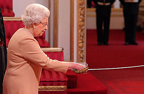 HM The Queen knighting a fine fellow (Press association via AP Images)