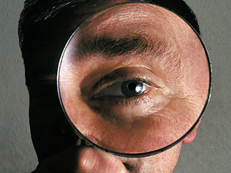 A detective and his magnifying glass