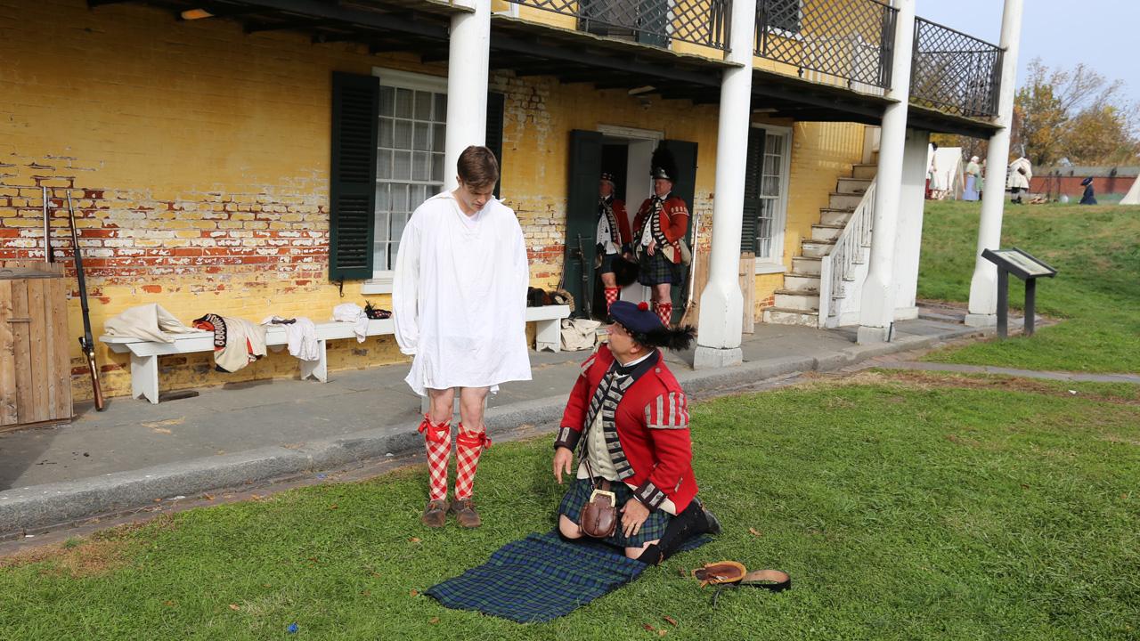 Georgie gets ready to put on an authentic kilt