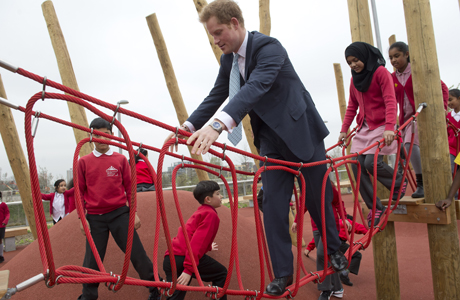 Prince Harry with local school children from Gainsborough Primary school in Newham at the new Queen Elizabeth Olympic Park. Prince Harry and Boris Johnson visit the new Queen Elizabeth Olympic Park, London, Britain - 04 Apr 2014  (Rex Features via AP Images)