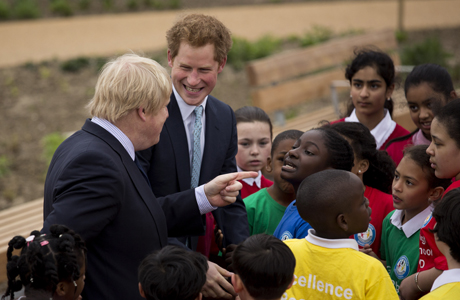 Britain's Prince Harry, second left, and London Mayor Boris Johnson chat with kids from Gainsborough Primary School as they visit the redeveloped Queen Elizabeth Olympic Park in London, Friday, April 4, 2014.  The park has been closed for redevelopment for 18 months since the end of the London 2012 Olympic and Paralympic Games and opens to the public on Saturday.  (AP Photo/Matt Dunham)