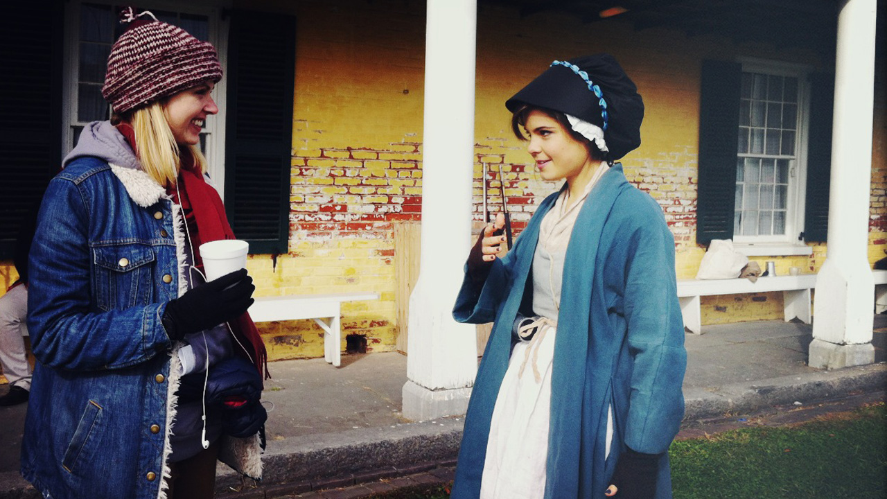 Poppy attempts to keep warm in her bonnet and mittens at Fort Mifflin