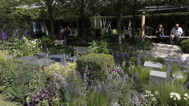 People take a rest in a show garden 'Hope on the Horizon'' designed by Matt Keightley. The garden is a contemplative space that represents the processwhich injured servicemen and women go through on the road to recovery. (AP Photo/Sang Tan)