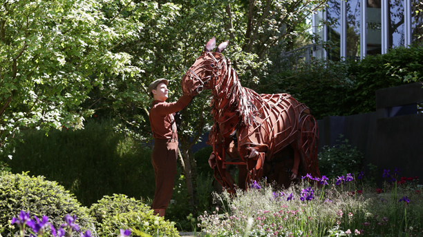 Chelsea Flower Show 2014. Joey, the three-man horse puppet from the theatre production of War Horse, in the 'No Man's Land' garden - a World War One commemorative garden by The Soldiers' Charity - during the press day at the RHS Chelsea Flower Show, at the Royal Hospital in Chelsea, London. Picture date: Monday May 19, 2014. Photo credit should read: (Yui Mok/PA/AP)