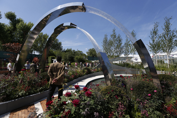 A visitor walks into a show garden 'Positively Stoke-on-Trent' at the Chelsea Flower Show in London, Monday, May 19, 2014. The Chelsea Flower show is a garden show held annually in May by the Royal Horticultural Society.  (AP Photo/Sang Tan)