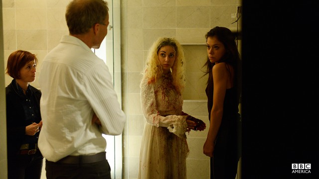 Tatiana Maslany as Sarah Manning and clone double Kathryn Alexandre as Helena filming episode 204's haunting shower sequence.