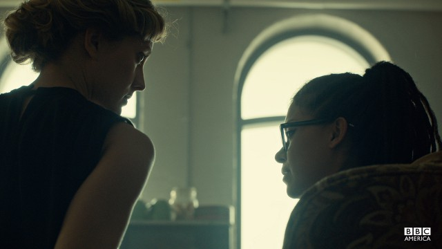 Delphine and Cosima share a tense moment in Leekie's lab.