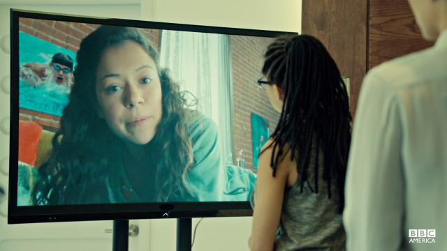 Cosima watches the video diaries of deceased clone, Jennifer Fitzsimmons.