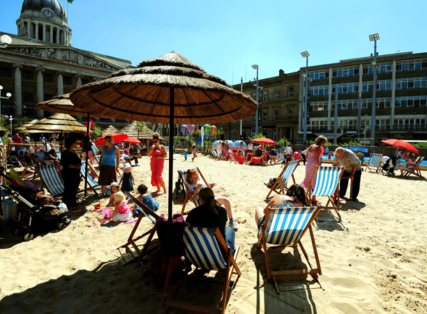 Summer weather July 19th. People enjoying the urban beach 'Nottingham Riviera' at Nottingham's city centre Market Square. Picture date: Friday July 19, 2013. Photo credit should read: Rui Vieira/PA Wire URN:17094582
