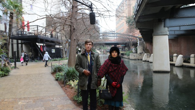 Behind the scenes, Poppy & Georgie are distracted by a boom pole along the San Antonio River Walk.