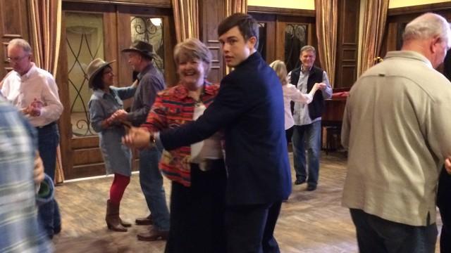 Georgie joins in the line dancing. San Antonio, TX.