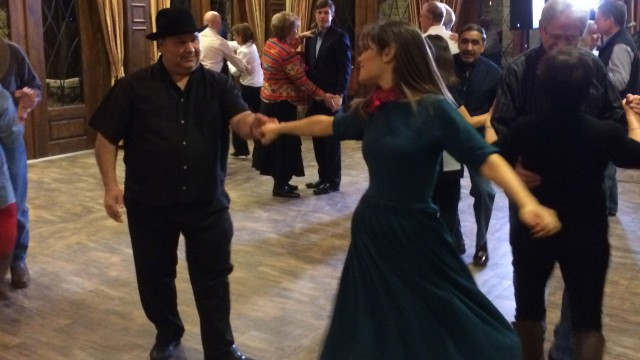 Poppy learns how to line dance from instructor Ancencio. San Antonio TX.