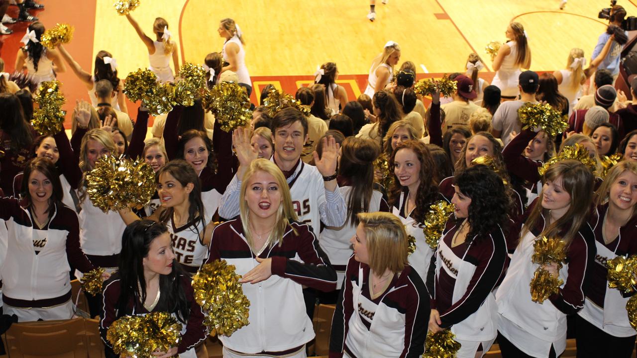 Georgie waves amongst the cheerleaders.