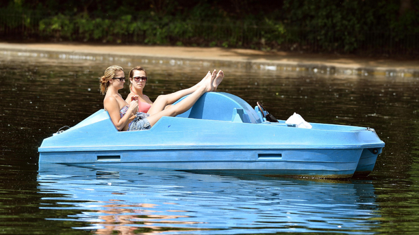 Summer Weather July 5. A couple of girls float in the Serpentine Lake in Hyde Park central London, as hot weather hits the capital city. Picture date: Friday July 5, 2013. Photo credit should read: John Stillwell/PA Wire URN:16991459