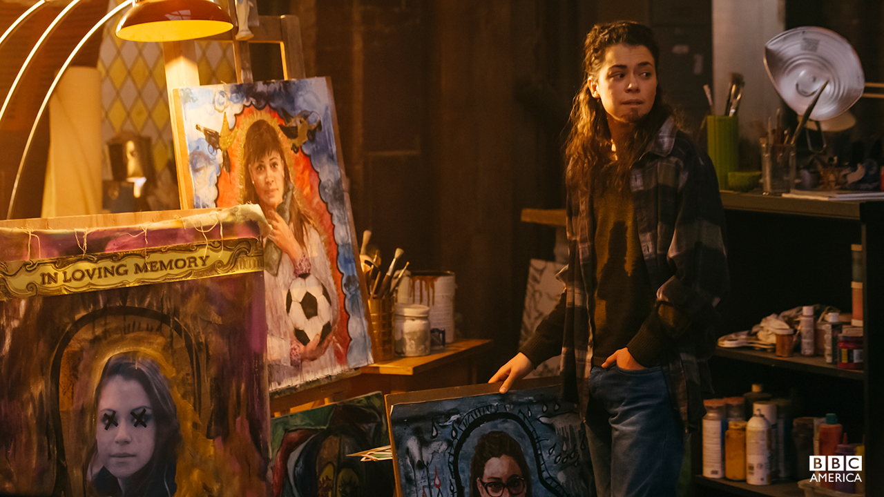"""Tony admires Fee's Twisted Sister clone art series. """"The one with the soccer ball looks like a douche,"""" Tony speculates."""