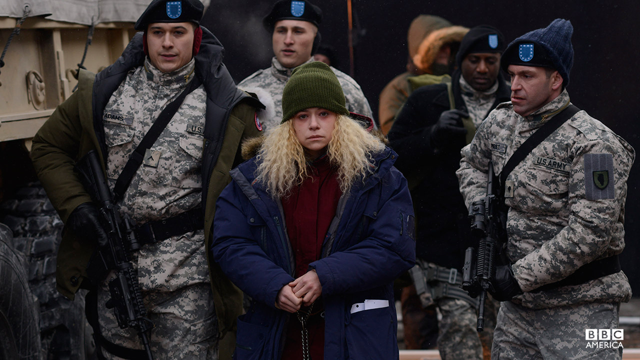 A captive Helena is taken by military forces to an undisclosed location.