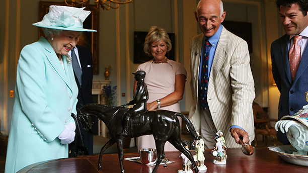 Queen Elizabeth II with Antiques Roadshow experts (from left) Hilary Kay, Paul Atterby and John Axford inspect a piece by French sculptor Pierre-Jules Mene of the 1863 Derby winner Macaroni, at Hillsborough Castle, Belfast during filming of the Antiques Roadshow on the third and final day of her visit to Northern Ireland. Picture date: Wednesday June 25, 2014. See PA story ROYAL Ulster. Photo credit should read: Brian Lawless/PA Wire URN:20217584