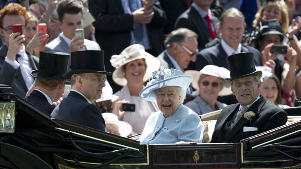 Britain's Queen Elizabeth II, centre, with Prince Philip, right, Prince Andrew, second right and Prince Harry, arrive by carriage, on the first day of the Royal Ascot horse racing meeting at Ascot, England,  Tuesday, June 17, 2014.  Royal Ascot is the annual five day horse race meeting that Britain's Queen Elizabeth II attends every day of the event.  (AP Photo/Alastair Grant)
