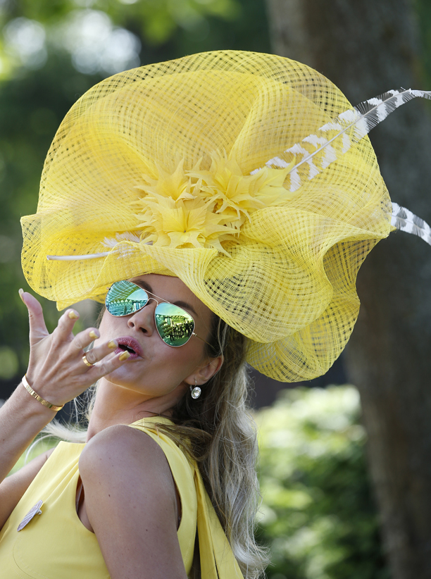 Ester Dohnalova poses for a photograph, on the first day of the Royal Ascot horse racing meeting, in Ascot, England, Tuesday, June 17, 2014. Royal Ascot is the annual five day horse race meeting attended daily by Queen Elizabeth II. (AP Photo/Alastair Grant)